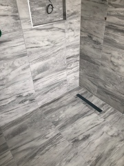 Grey porcelain wet room with niche